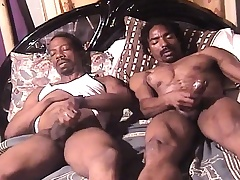 Yoke blue and horny dark skinned studs masturbate together on the bed